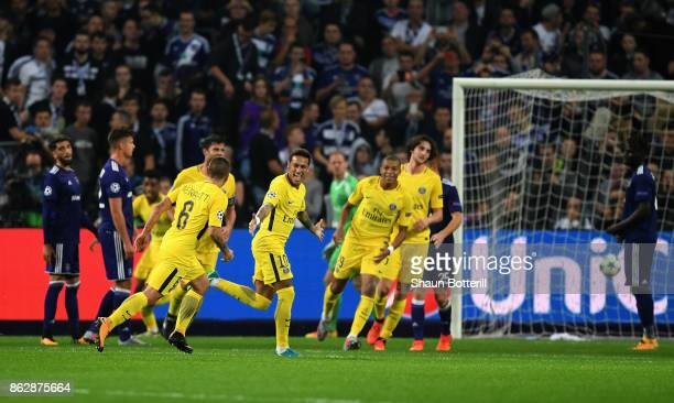 Neymar of PSG celebrates scoring his sides third goal with his PSG team mates during the UEFA Champions League group B match between RSC Anderlecht...