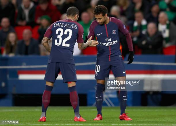 Neymar of PSG celebrates scoring his team's first goal with Dani Alves during the UEFA Champions League group B match between Paris Saint-Germain and...