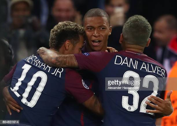 Neymar of PSG celebrates with Kylian Mbappe of PSG and Dani Alves of PSG after scoring his sides third goal during the UEFA Champions League group B...