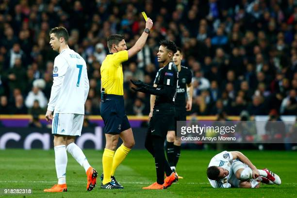 Neymar of PSG is given a yellow card during the UEFA Champions League Round of 16 First Leg match between Real Madrid and Paris SaintGermain at...