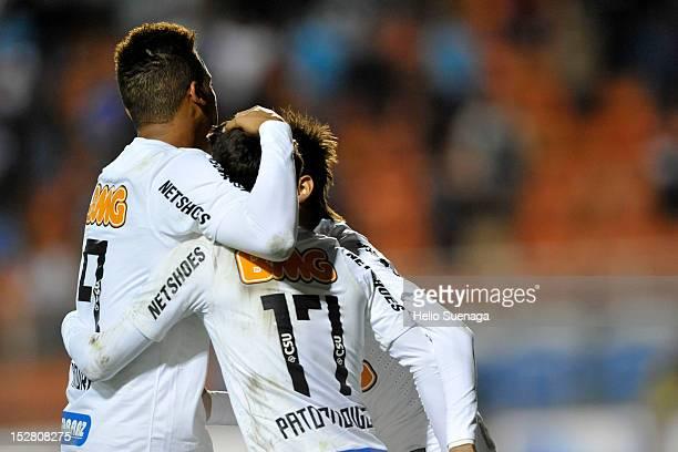 Neymar of Santos celebrates a scored goal during a match between Santos and Universidad do Chile as part of the Recopa Sudamericana 2012 at Pacaembu...