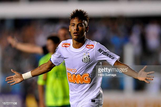 Neymar of Santos celebrates a scored goal during a match between Santos and Palmeiras as part of the Brazilian Serie A Championship 2012 at Vila...