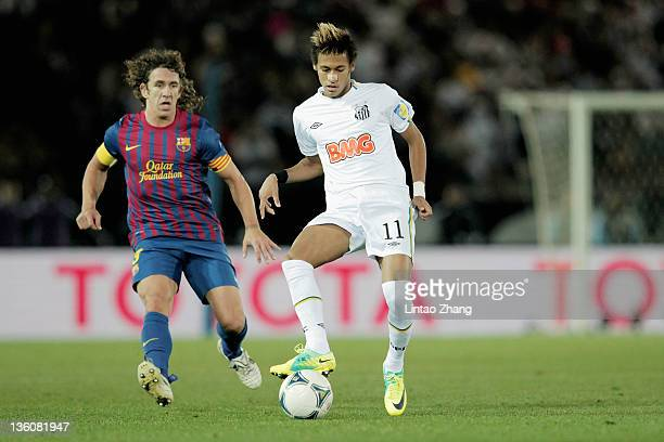 Neymar of Santos challenged by Carles Puyol of FC Barcelona during the FIFA Club World Cup Final match between Santosl and Barcelona at the Yokohama...
