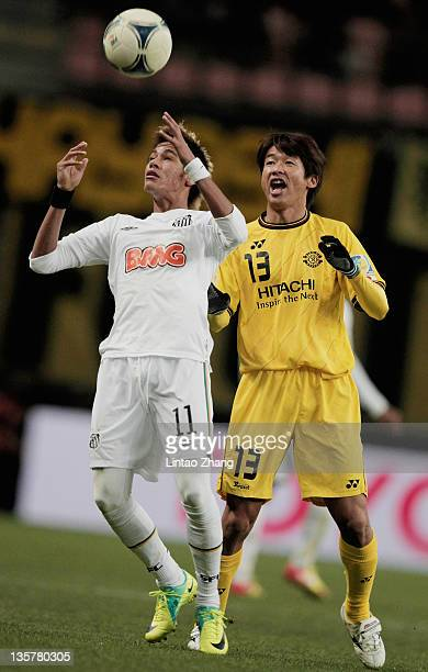 Neymar of Santos competes for an aerial ball with Akihiro Hyodo of Kashiwa Reysol during the FIFA Club World Cup semi final match between Kashiwa...