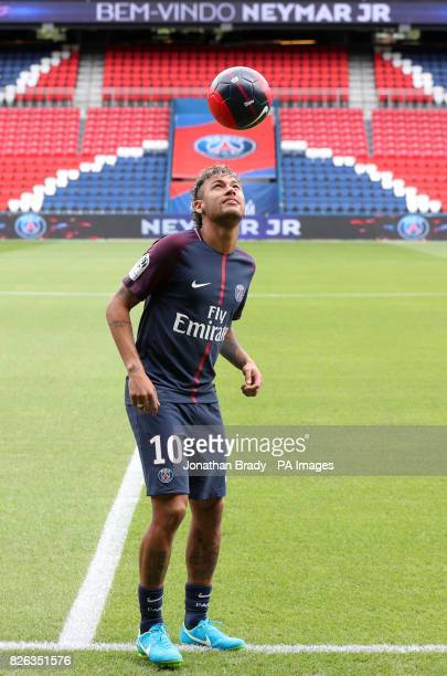 Neymar performs skills pitchside after a press conference at the Parc des Princes following his world record breaking £200million transfer from FC...