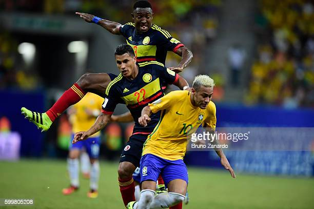 Neymar player of Brazil battles for the ball with Players of Colombia during 2018 FIFA World Cup Russia qualification match between Brazil and...