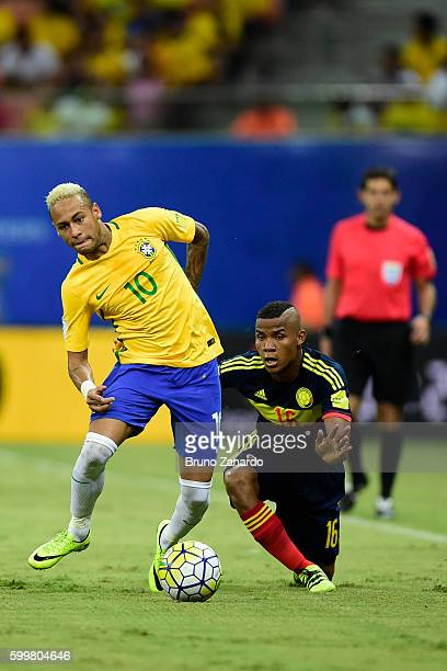 Neymar player of Brazil competes for the ball with Wlmar Barrios player of Colombia during 2018 FIFA World Cup Russia qualification match between...