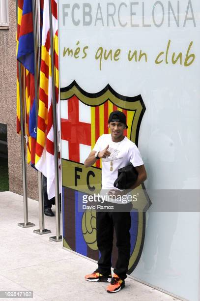 Neymar poses for the media after signing as a new player of the FC Barcelona at Camp Nou sports complex on June 3 2013 in Barcelona Spain