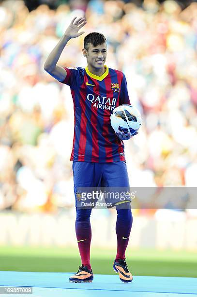 Neymar poses for the media after signing as a new player of the FC Barcelona at Camp Nou Stadium on June 3 2013 in Barcelona Spain