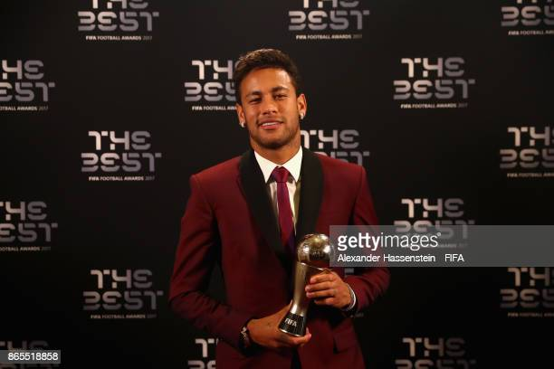 Neymar poses with his award after being included in the team of the year during The Best FIFA Football Awards at The London Palladium on October 23...