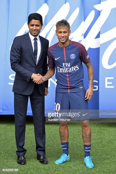 Neymar poses with his new jersey next to Paris SaintGermain President Nasser AlKhelaifi after a press conference on August 4 2017 in Paris France...