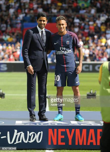 Neymar poses with president Nasser AlKhelafi during his presentation to the fan during the French Ligue 1 match between Paris Saint Germain and...