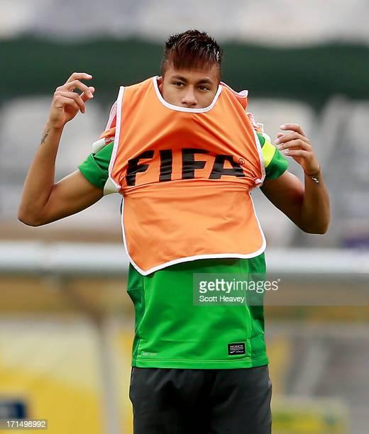 Neymar puts on a FIFA training bib during a Brazil training session ahead of their FIFA Confederations Cup 2013 Semi Final match against Uruguay on...