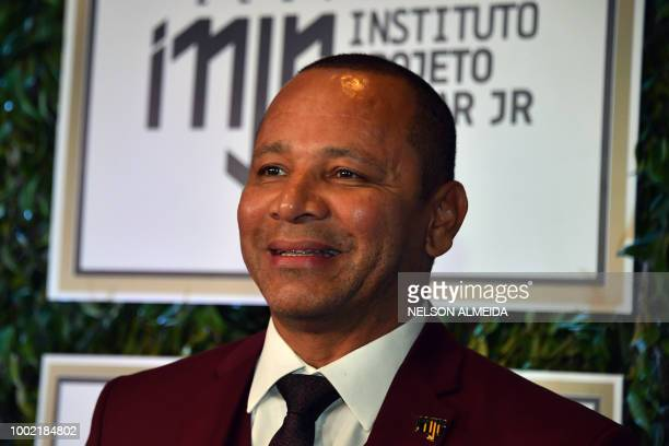 Neymar Santos father of Brazilian superstar and PSG's footballer Neymar Junior arrives to participate in the charity auction of the Neymar Jr...