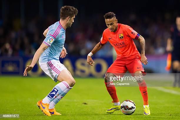 Neymar Santos Jr of FC Barcelona challenges Andreu Fontas of Celta Vigo during the La Liga match between Celta Vigo and FC Barcelona at Estadio...