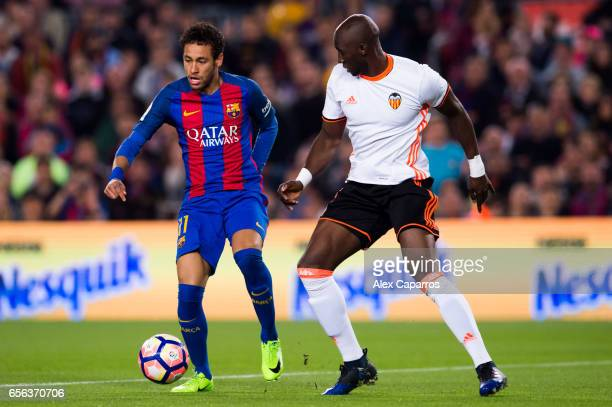 Neymar Santos Jr of FC Barcelona competes for the ball with Eliaquim Mangala of Valencia CF during the La Liga match between FC Barcelona and...