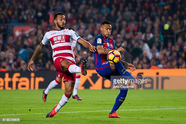 Neymar Santos Jr of FC Barcelona competes for the ball with Ruben Vezo of Granada CF during the La Liga match between FC Barcelona and Granada CF at...