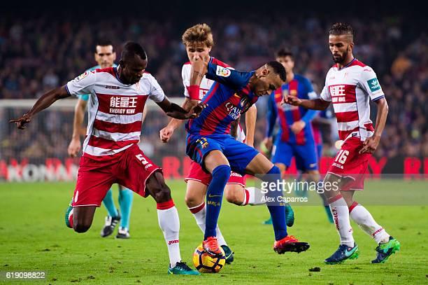 Neymar Santos Jr of FC Barcelona controls the ball between Uche Henry Agbo Sergi Samper and Mehdi CarcelaGonzalez of Granada CF during the La Liga...