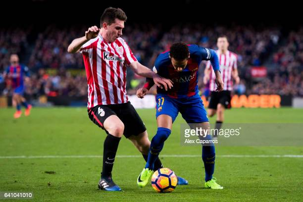 Neymar Santos Jr of FC Barcelona fights for the ball with Aymeric Laporte of Athletic Club during the La Liga match between FC Barcelona and Athletic...