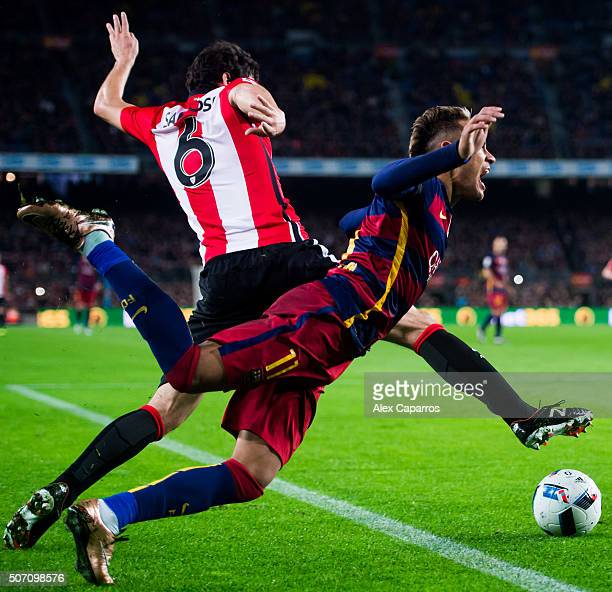 Neymar Santos Jr of FC Barcelona is brought down by Mikel San Jose of Athletic Club during the Copa del Rey Quarter Final Second Leg between FC...