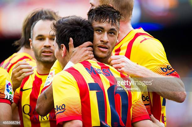 Neymar Santos Jr of FC Barcelona is congratulated by his teammates after scoring his second team's goal during the La Liga match between FC Barcelona...