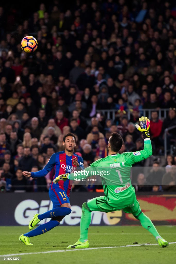 Neymar Santos Jr (L) of FC Barcelona shoots the ball over goalkeeper Sergio Alvarez of RC Celta de Vigo and scores his team's second goal during the La Liga match between FC Barcelona and RC Celta de Vigo at Camp Nou stadium on March 4, 2017 in Barcelona, Spain.
