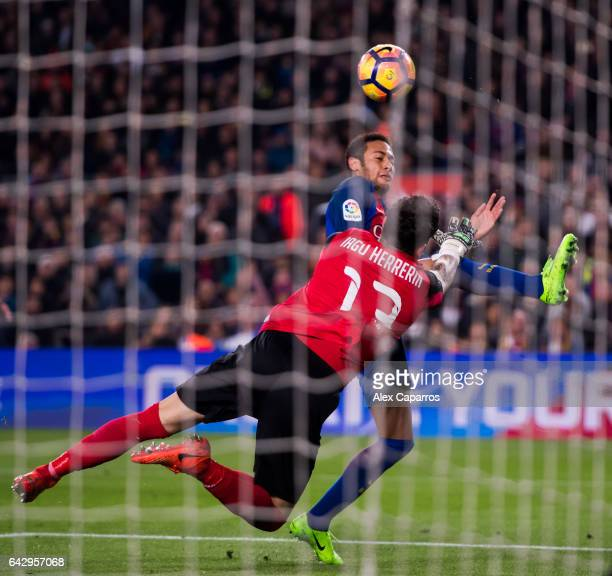 Neymar Santos Jr of FC Barcelona tries to reach the ball with the opposition of goalkeeper Iago Herrerin of CD Leganes during the La Liga match...