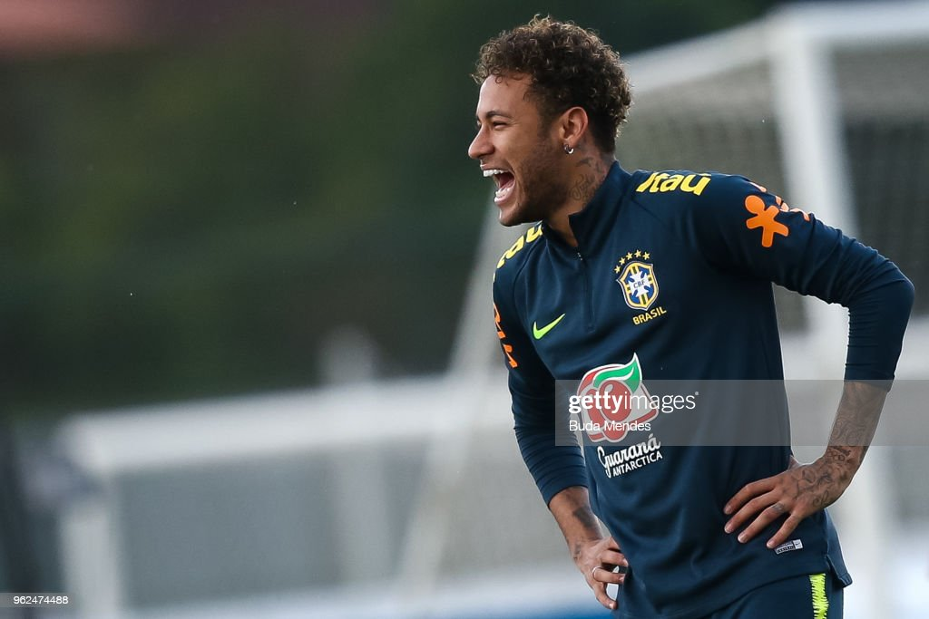 Neymar smiles during a training session of the Brazilian national football team at the squad's Granja Comary training complex on May 25, 2018 in Teresopolis, Brazil.