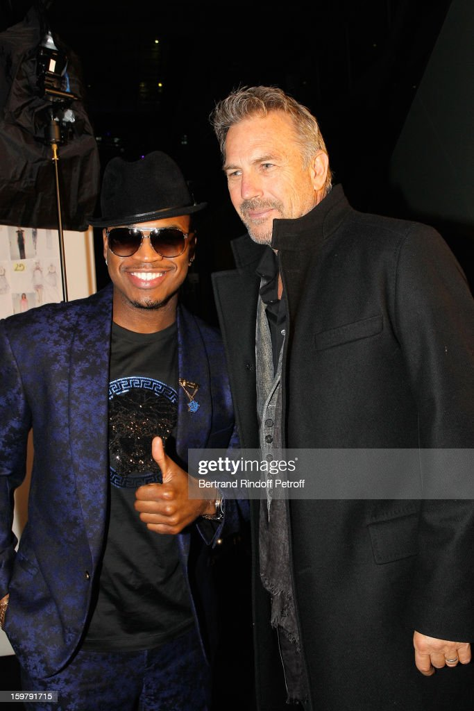 Ne-Yo (L) and Kevin Costner attend the Versace Spring/Summer 2013 Haute-Couture show as part of Paris Fashion Week at Le Centorial on January 20, 2013 in Paris, France.