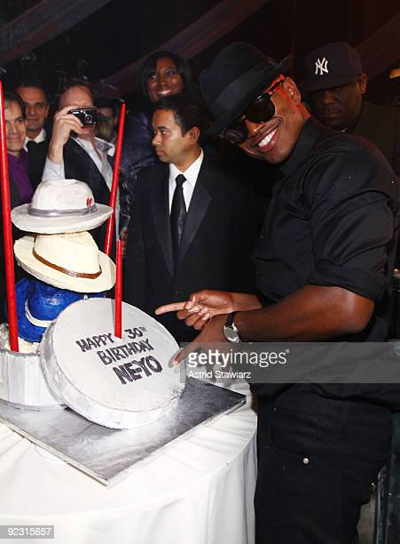 """Ne-Yo poses beside his birthday cake during his 30th Birthday Bash """"Cold As Ice"""" at Cipriani 42nd Street on October 17, 2009 in New York City."""
