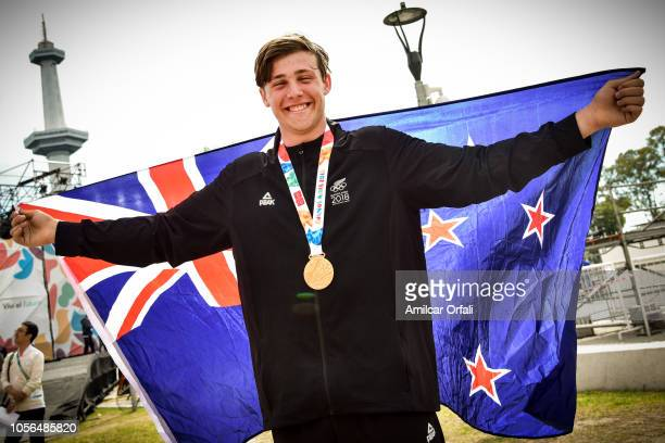 Nez Zealand flag bearer for the Closing Ceremony Connor Bell poses during an exclusive photo shoot with New Zealand medal winner on day 12 of Buenos...