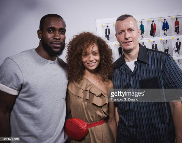 Nfl Player Kam Chancellor his wife Tiffany Luce and Designer Lucas Ossendrijver attend the Lanvin Menswear Spring/Summer 2019 show as part of Paris...
