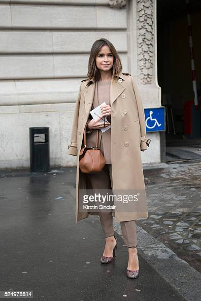 'nFounder of digital company 24/7 Miroslava Duma wears a Calvin Klein suit and Gucci coat on day 7 during Paris Fashion Week Autumn/Winter 2016/17 on...
