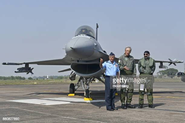Ng Eng Hen Singapore's defense minister center poses for a photograph after his flight in an Indian Air Force Tejas fighter jet at the Kalaikunda Air...
