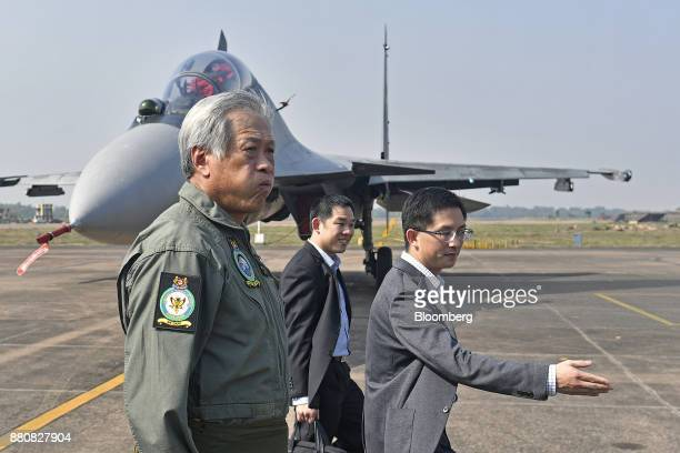 Ng Eng Hen Singapore's defense minister center walks after his flight in an Indian Air Force Tejas fighter jet at the Kalaikunda Air Force Sation...