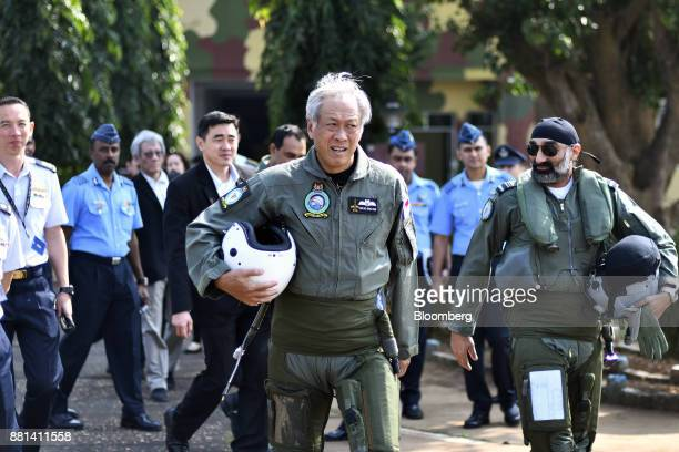 Ng Eng Hen Singapore's defense minister center walks to an Indian Air Force Tejas fighter jet prior to a flight at the Kalaikunda Air Force Station...