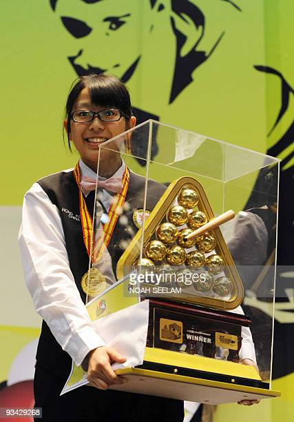 Ng On Yee of Hong Kong poses with the winners trophy after winning the women's title of the World Snooker championship held at the Hyderabad...