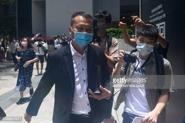 Tang Ying Bun , who was one of eight men accused of attacking pro-democracy protesters in Yuen Long in 2019, leaves the District Court after he was...