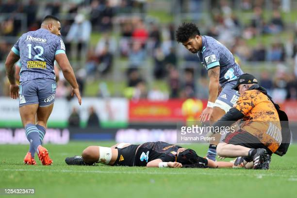 Ngani Laumape and Ardie Savea of the Hurricanes check on Naitoa Ah Kuoi of the Chiefs during the round 4 Super Rugby Aotearoa match between the...