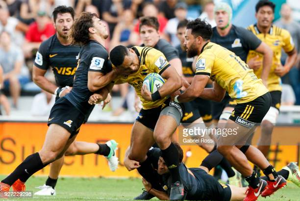 Ngani Laumape of Hurricanes is tackled by Bautista Ezcurra of Jaguares during a match between Jaguares and Hurricanes as part of third round of Super...