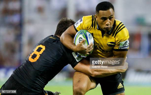 Ngani Laumape of Hurricanes is tackled by Tomas Lezana of Jaguares during a match between Jaguares and Hurricanes as part of third round of Super...