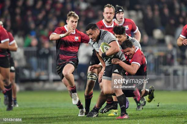 Ngani Laumape of the All Blacks is tackled by Whetu Douglas of Canterbury during the Game of Three Halves between the New Zealand All Blacks and...