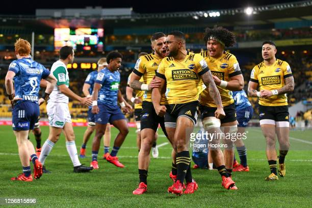 Ngani Laumape of the Hurricanes celebrates with TJ Perenara and Du'Plessis Kirifi after scoring a try during the round 6 Super Rugby Aotearoa match...
