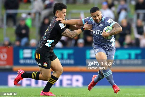 Ngani Laumape of the Hurricanes fends off Tumua Manu of the Chiefs during the round 4 Super Rugby Aotearoa match between the Chiefs and the...