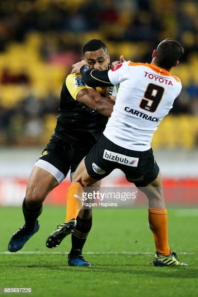 Ngani Laumape of the Hurricanes is tackled by Shaun Venter of the Cheetahs during the round 13 Super Rugby match between the Hurricanes and the...