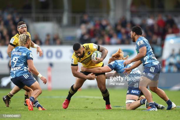 Ngani Laumape of the Hurricanes is tackled during the round 1 Super Rugby Aotearoa match between the Blues and the Hurricanes at Eden Park on June...