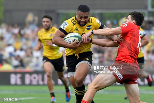 Ngani Laumape of the Hurricanes makes a break during the round five Super Rugby match between the Hurricanes and the Sunwolves at McLean Park on...