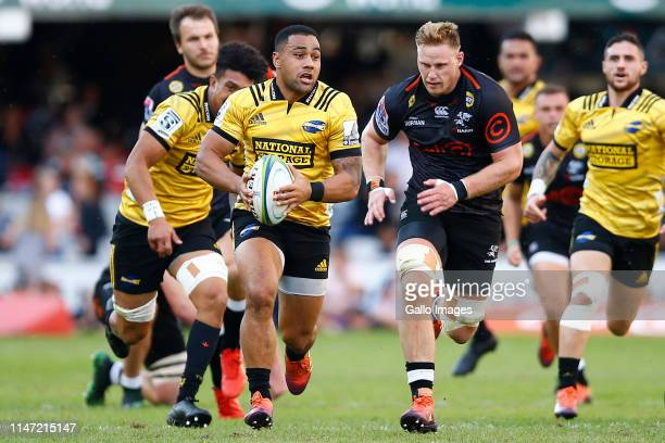 Ngani Laumape of the Hurricanes runs with the ball on attack during the Super Rugby match between Cell C Sharks and Hurricanes at Jonsson Kings Park...