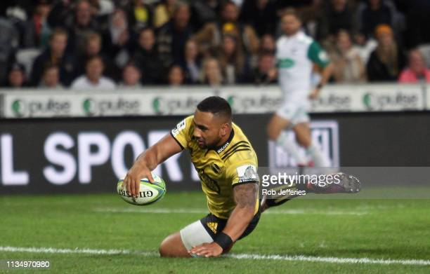 Ngani Laumape of the Hurricanes scores a try during the round 8 Super Rugby match between the Highlanders and Hurricanes at Forsyth Barr Stadium on...