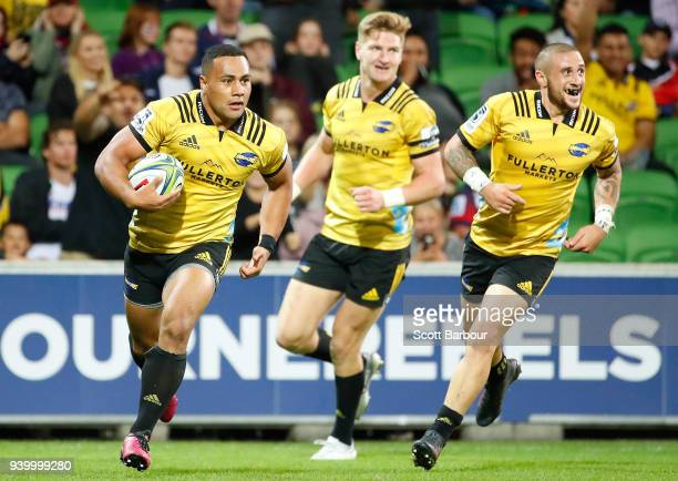 Ngani Laumape of the Hurricanes scores a try during the round seven Super Rugby match between the Rebels and the Hurricanes at AAMI Park on March 30...
